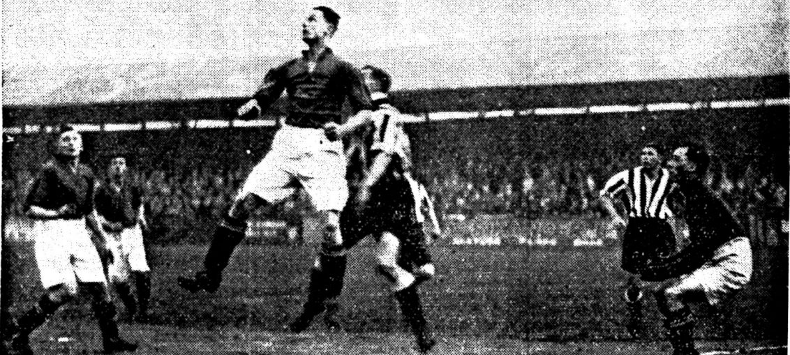 Gilchrist, the visitors right back, heading away from a centre from Carter while Swift, the former Southport Goalkeeper, looks on.