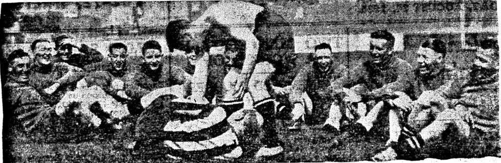 Proudfoot and Seagrave indulge in a wrestling bout during a respite in training at Haig Avenue