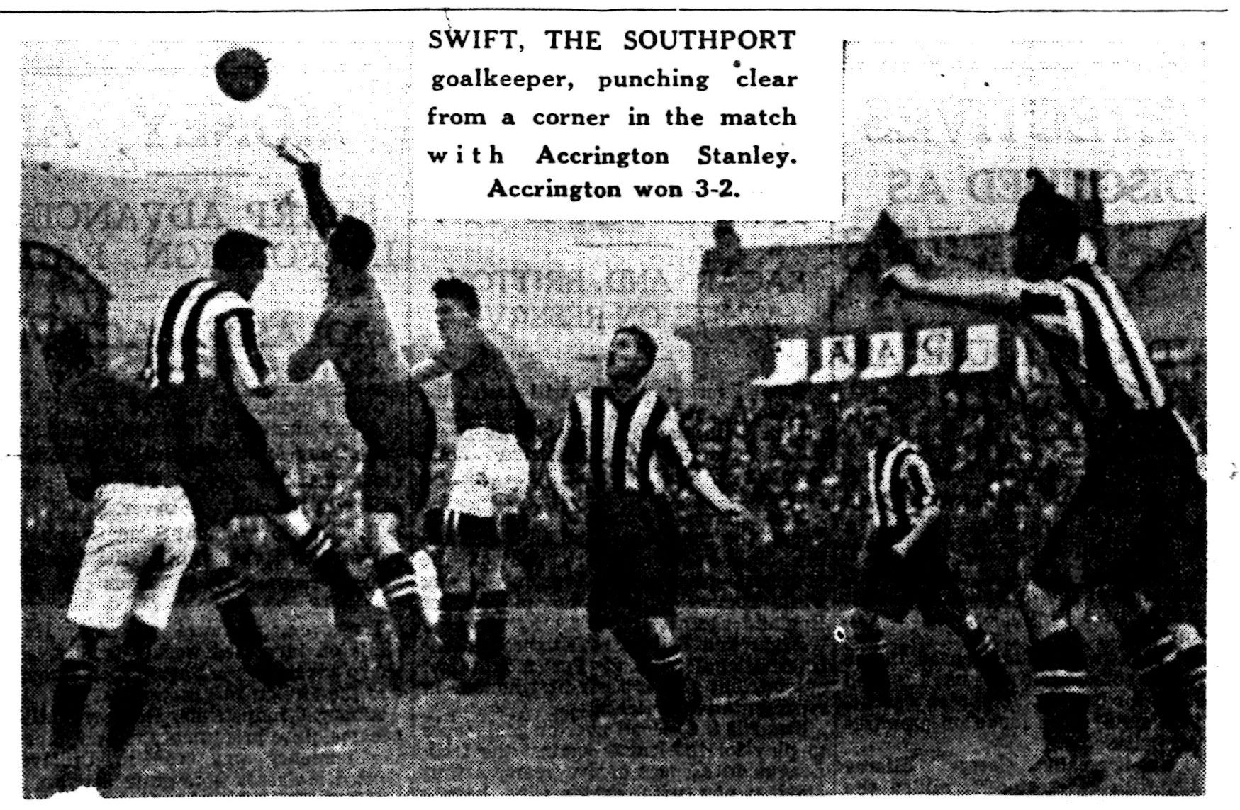 Swift, the southport goalkeeper, punching clear from a corner in the match with Accrington Stanley.